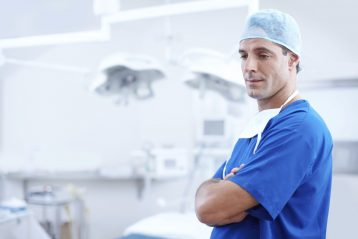 A surgeon dressed in scrubs.