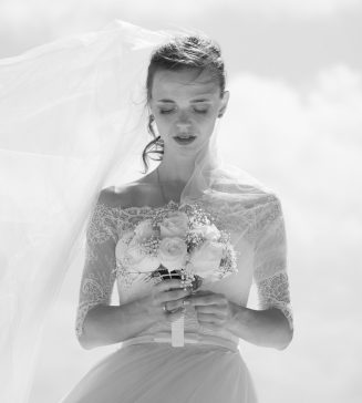 Black and white photo of a bride holding a bouquet.