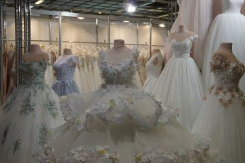 Wedding dresses on display on mannequins.