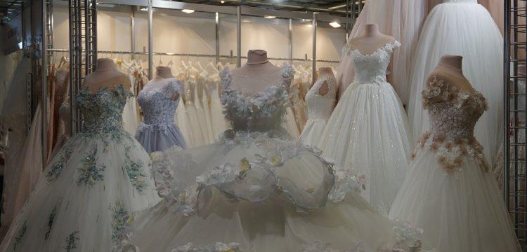 Wedding dresses on display on mannequins.