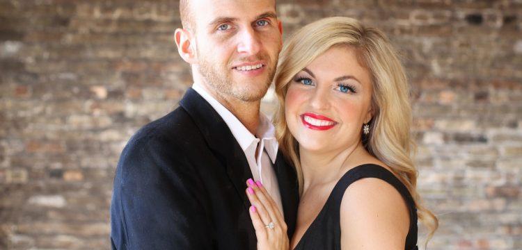 Engaged couple posing.