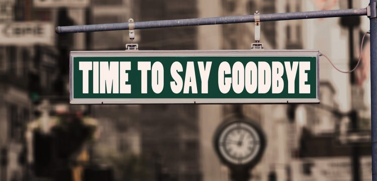 """A sign that reads, """"Time to Say Goodbye""""."""