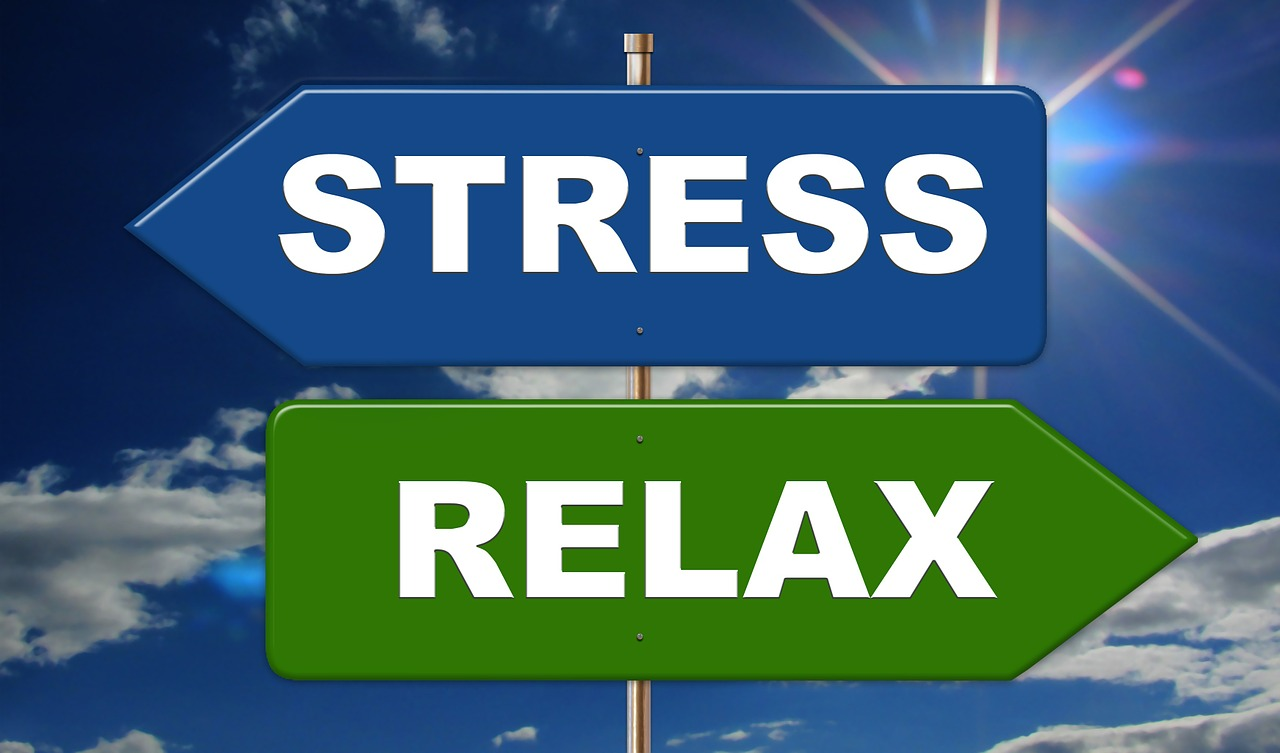 """Signs saying """"Stress"""" and """"Relax""""."""