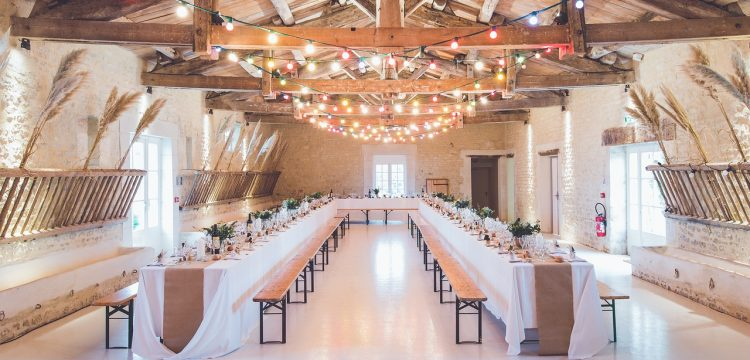 Wedding reception with tables and lights.