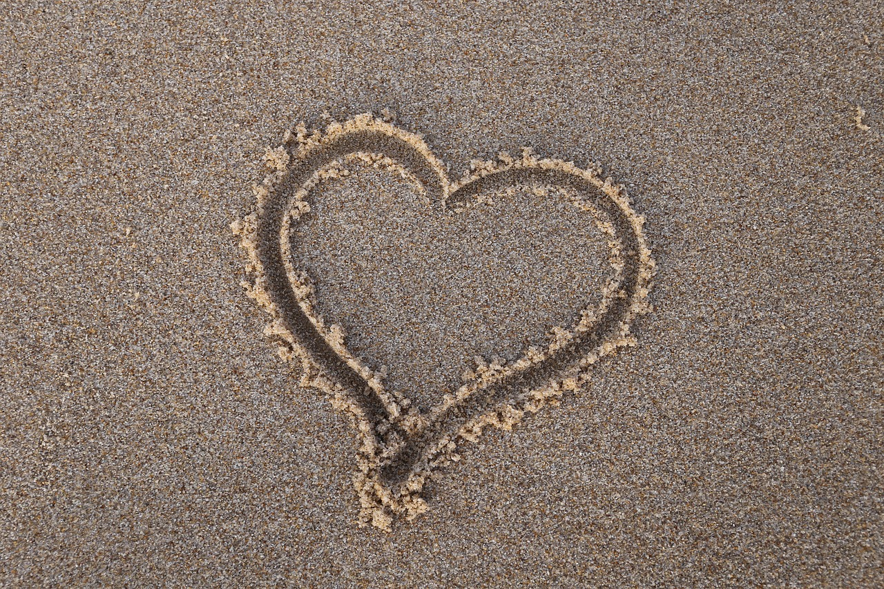 A heart drawn in the sand.