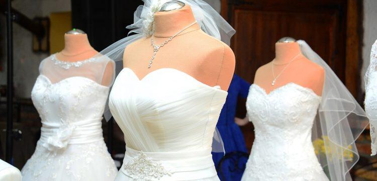 Three wedding gowns on mannequins.