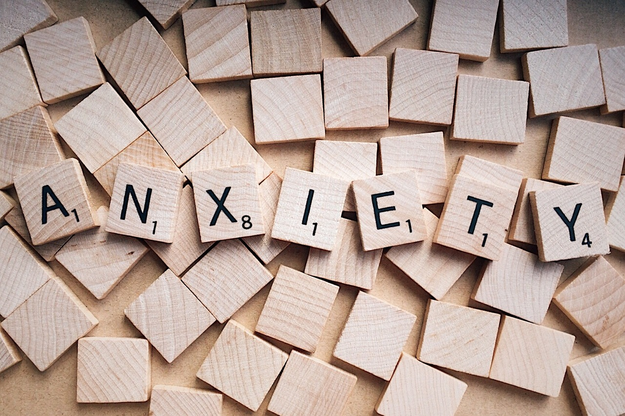 "The word, ""Anxiety"" spelled out in Scrabble letters."