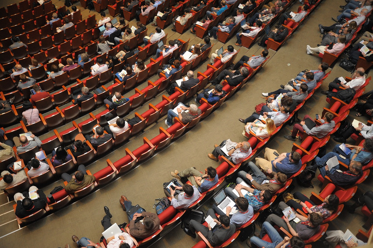 Rows of people at a conference.