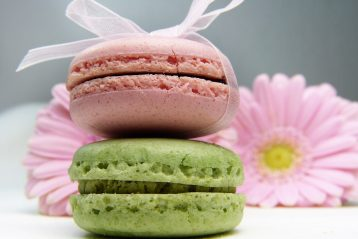 Two macaron cookies, tied with ribbon.