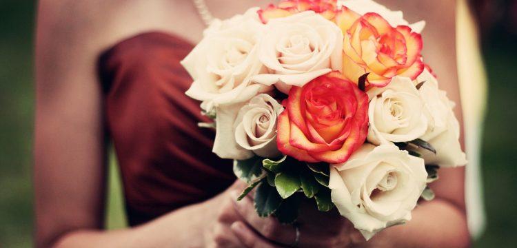 Bridesmaid holding a bouquet.