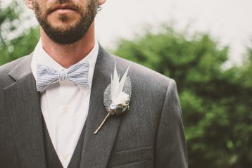 A groom with a beard.
