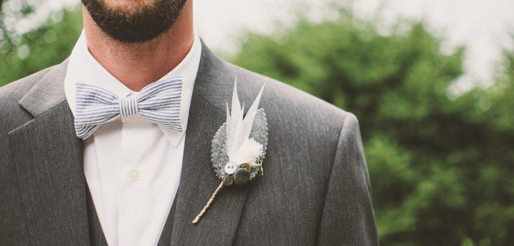 A groom with a beard.