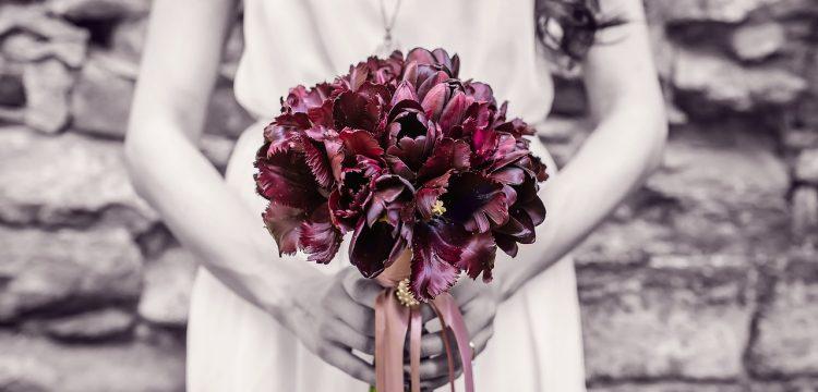 Bridesmaid holding bouquet.