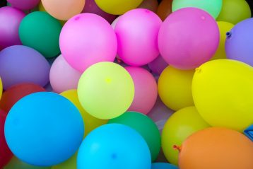 A bunch of brightly colored balloons.