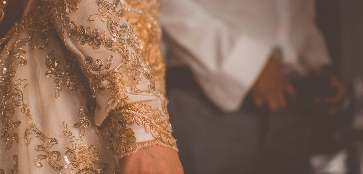 Bride wearing a gold gown.