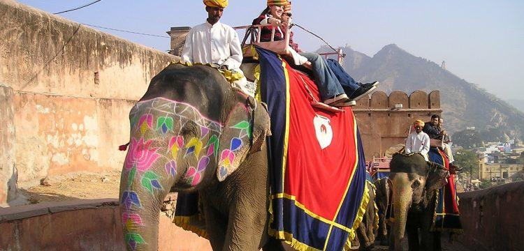 Men riding an Indian elephant.
