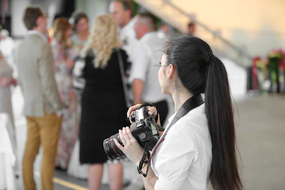 Woman holding a camera.
