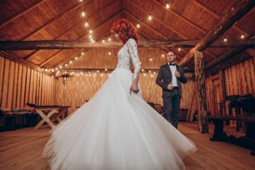 Bride and groom having a barn wedding.