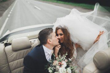 Couple in a honeymoon getaway car.