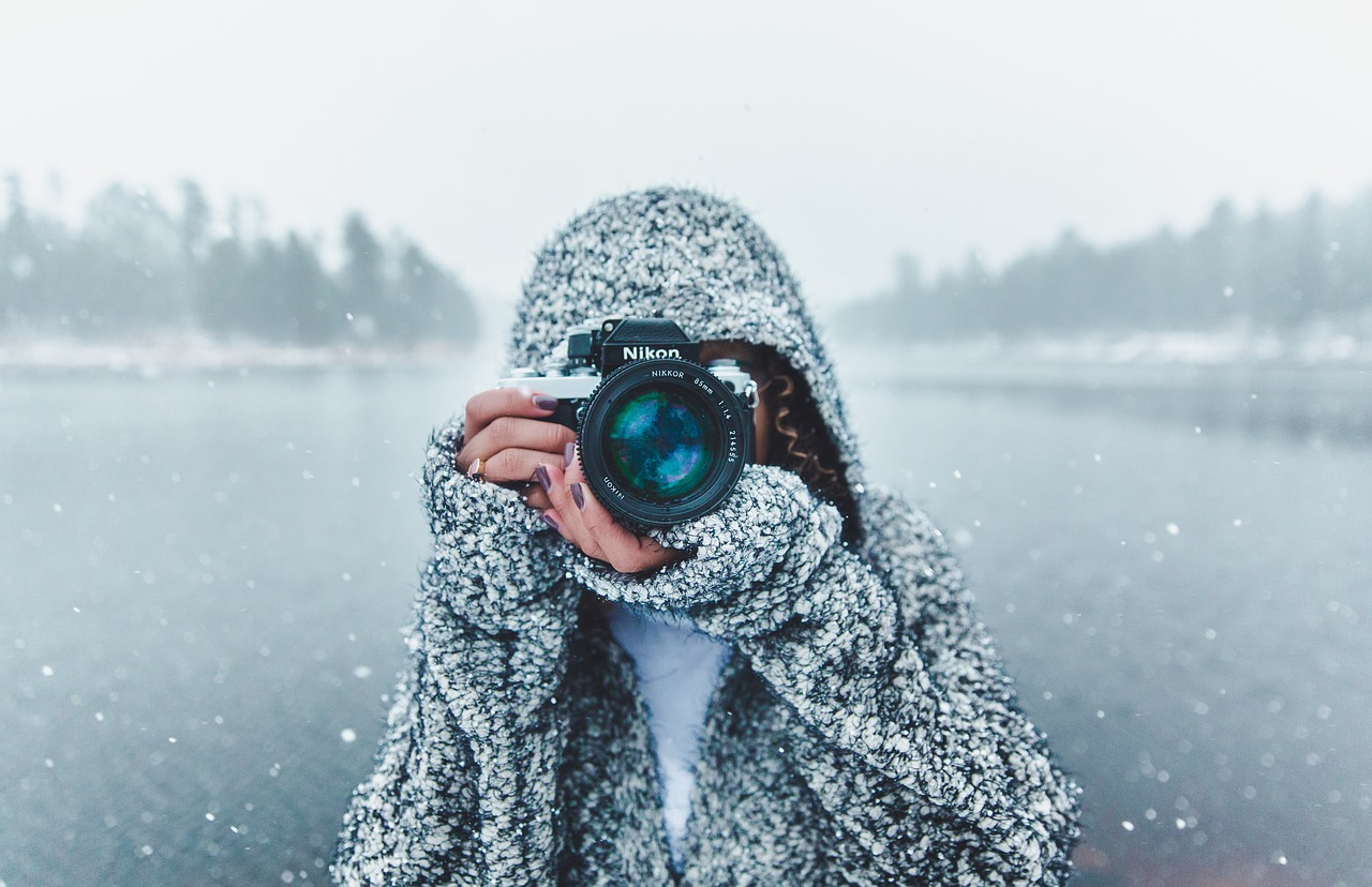 Photographer taking pictures in a beautiful winter scene.