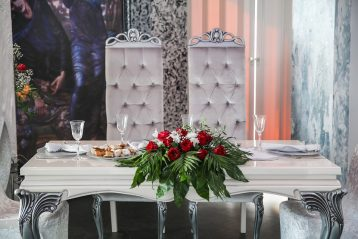 A bride and groom's reception table, beautifully decorated.