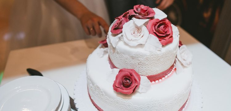 Wedding cake with red rose icing.