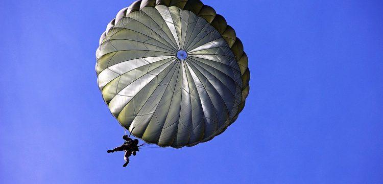 Man parachuting to the ground.