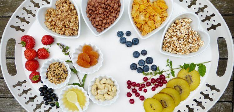 Platter full of vegan food alternatives, including some in heart-shaped bowls.