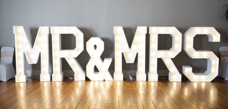 Big lighted letters that spell out Mr. & Mrs.