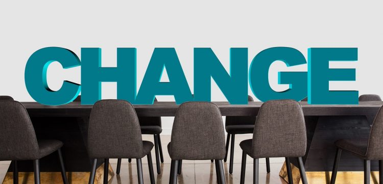 """A boardroom with the word """"change"""" on it."""