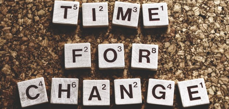 """Scrabble letters that spell out """"Time for Change""""."""