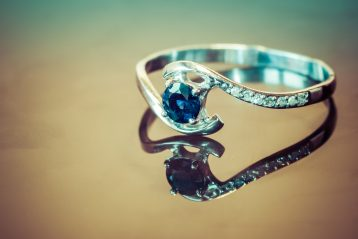 A diamond and sapphire engagement ring.