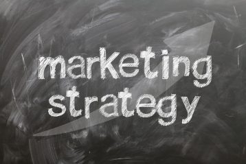 "The words ""marketing strategy"" with an upward arrow."