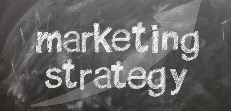 "The words ""marketing strategy"" with an upward arrow."