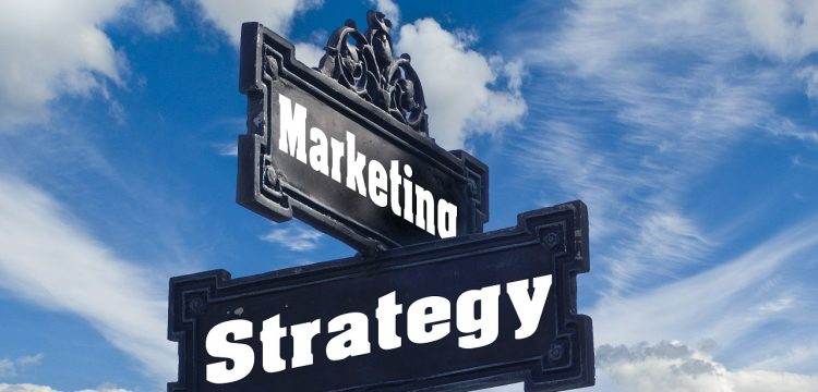 """Signposts that read """"Marketing"""" and """"Strategy""""."""