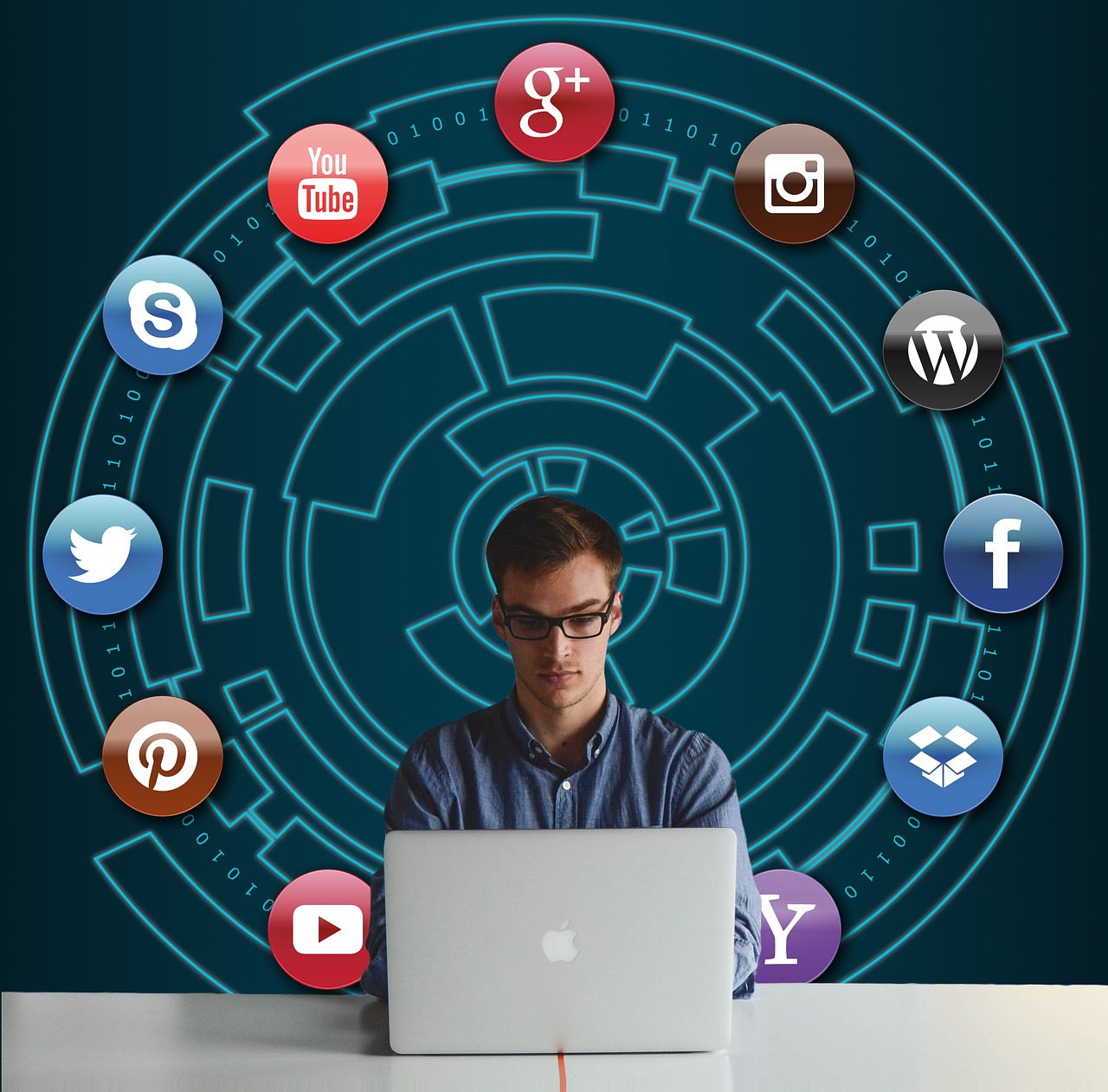 Man sitting at a laptop with various social media icons surrounding him.