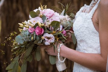 A bride holding a bouquet of flowers.