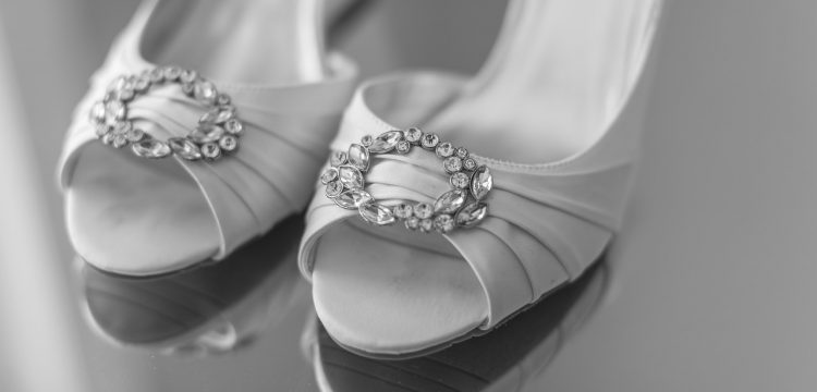White wedding heels with jewels on them.