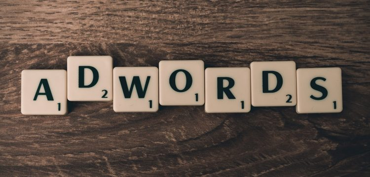 """Scrabble letters spelling out """"AdWords""""."""