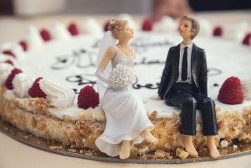 Bride and groom figurines on a non-traditional wedding cake.