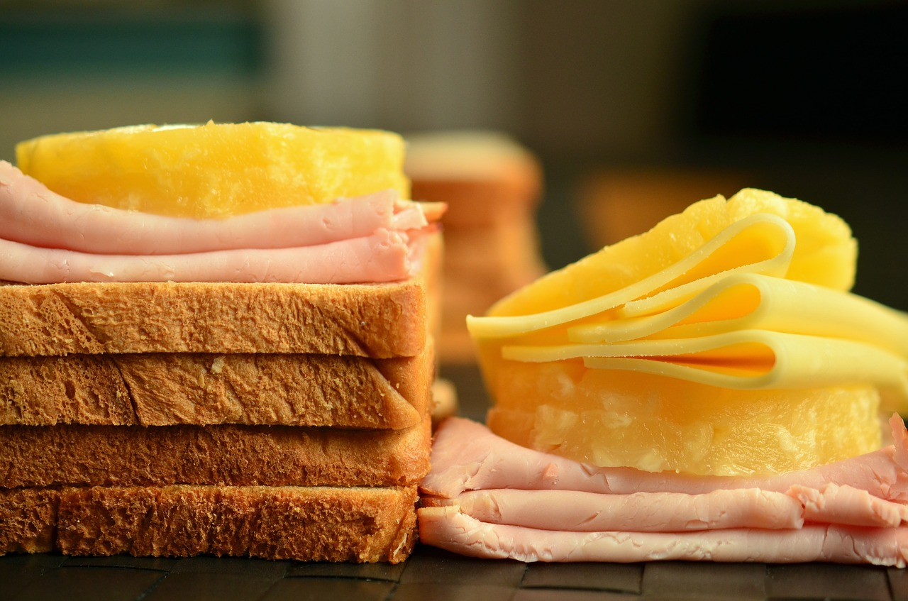 Sliced cheese and meat on bread.