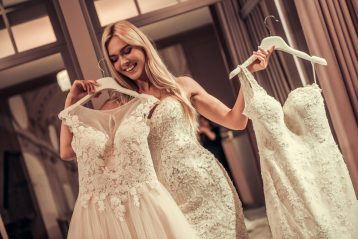 A bride trying on gowns.