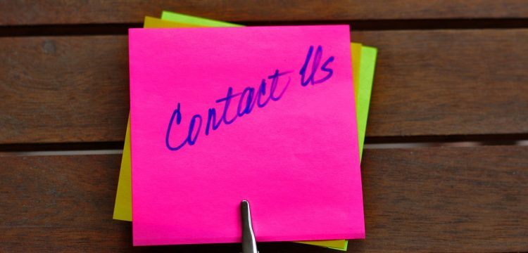 """Sticky note that reads, """"Contact Us""""."""