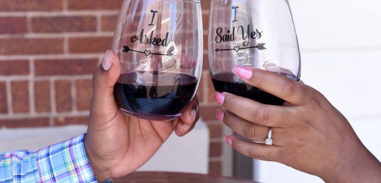 An engaged couple raising a toast.