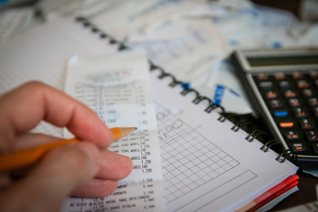 Receipts, a calculator, and graph notebook, indicating taxes.