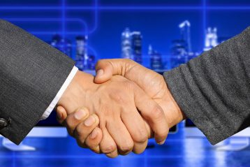 A handshake signifying a merger.