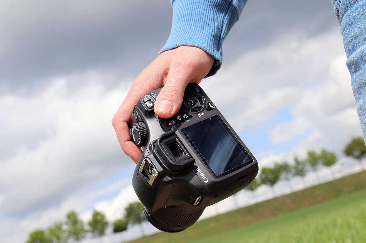 A person holding a camera.