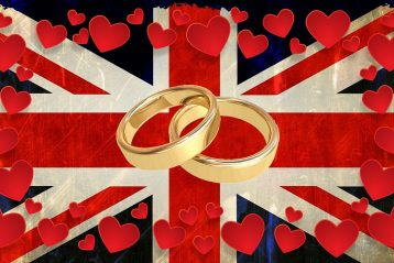 Wedding bands surrounded by hearts on a flag of Great Britain.