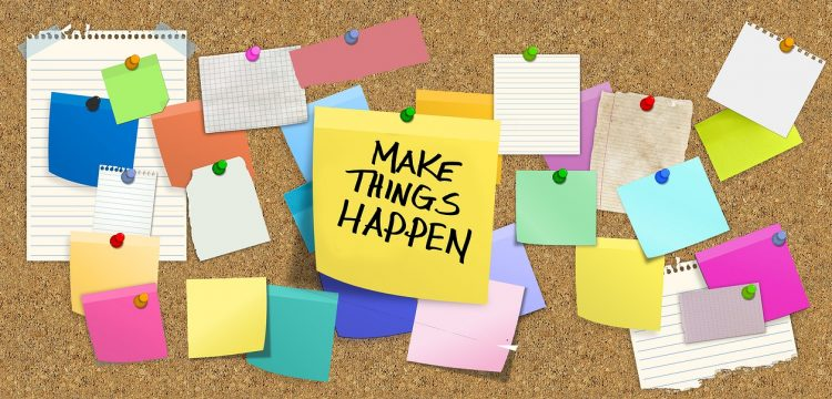 """The words, """"Make Things Happen"""" on a corkboard to signify an idea(s)."""