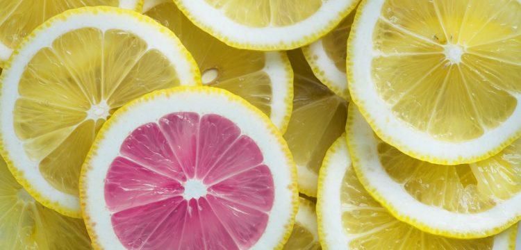 Yellow lemon slices and one pink grapefruit slice.